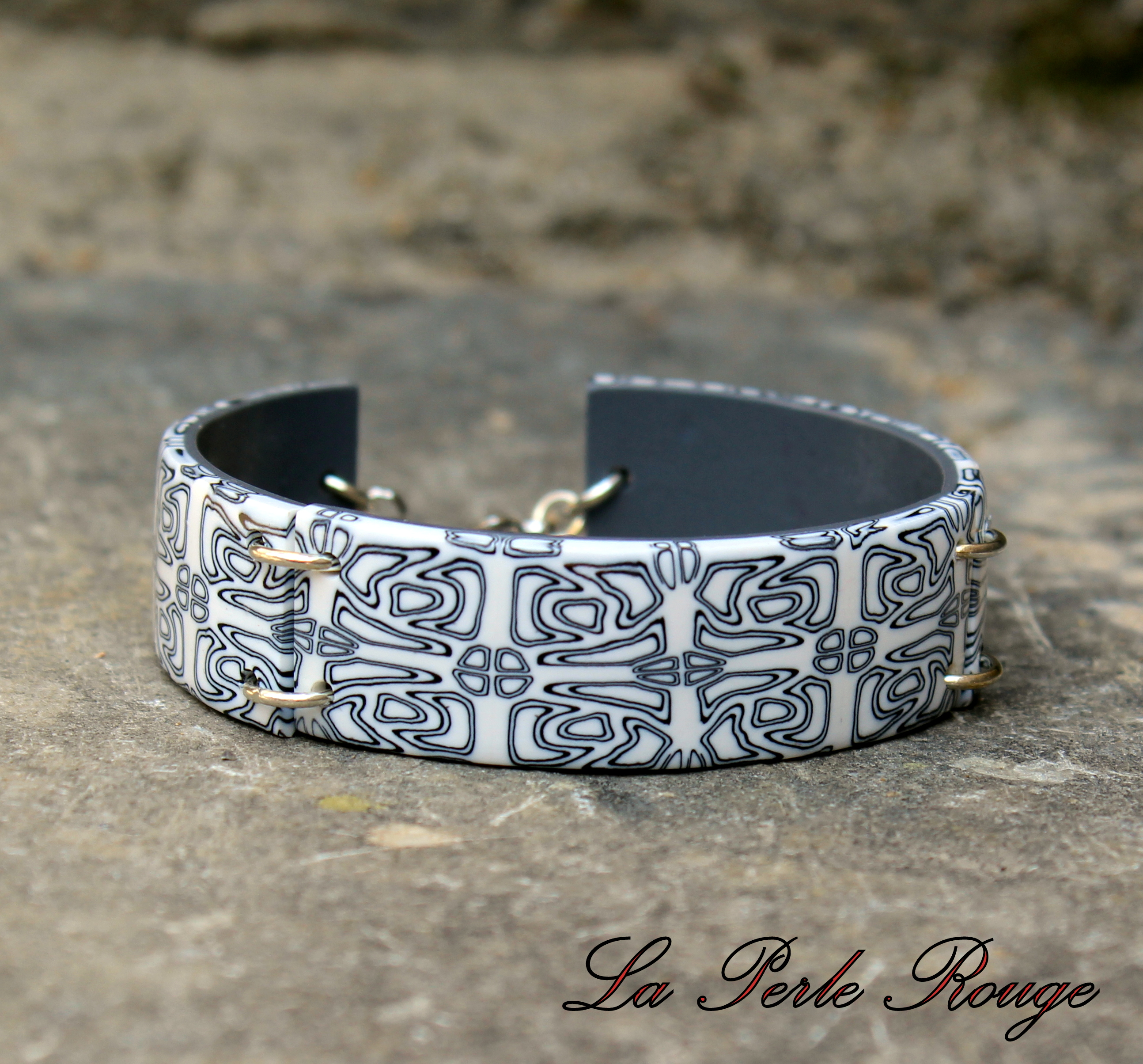Bracelet rigide noir et blanc